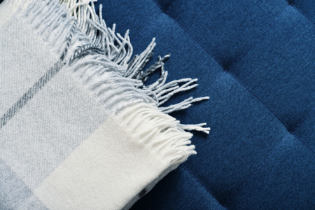 accessorize: Woolen plaid on blue background, top view