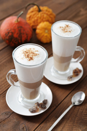 breackfast: Pumpkin spice latte with cinnamon and decorative pumpkins
