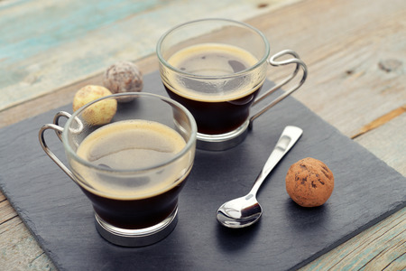 cups of coffee: Two glass cups of coffee on slate tray Stock Photo