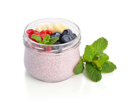 glass jars: Pudding with chia seeds, yogurt and fresh fruits in glass jars isolated on white background