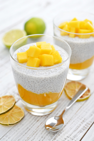 souffle: Chia seed pudding with mango and lime on wooden background