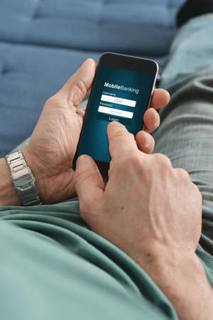 purchases: Male hands using online banking on smart phone Stock Photo