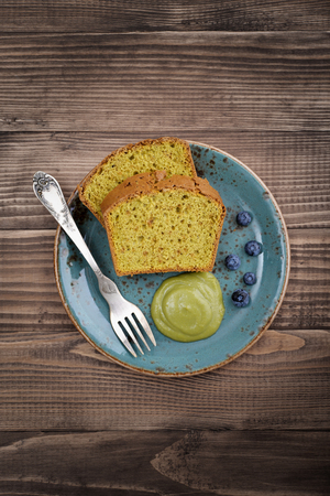 cakes and pastries: Pound cake with tea matcha curd on plate top view