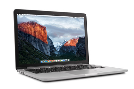 display retina: Kiev, Ukraine - May 15, 2016:Brand new Macbook Pro with with Retina display and OS X EL Capitan isolated. MacBook is a brand of notebook computers manufactured by Apple Inc.