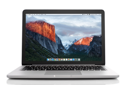 icloud: Kiev, Ukraine - May 15, 2016:Brand new Macbook Pro with with Retina display and OS X EL Capitan isolated. MacBook is a brand of notebook computers manufactured by Apple Inc.