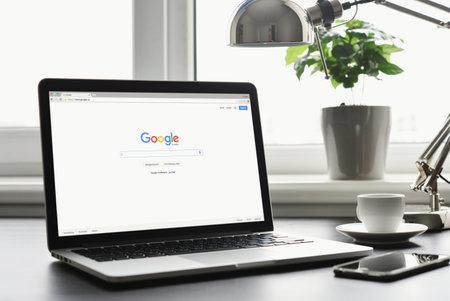 Kiev, Ukraine - May 15, 2016: Macbook Pro with Google app on screen. Google biggest Internet search engine. Google.com domain was registered September 15, 1997.