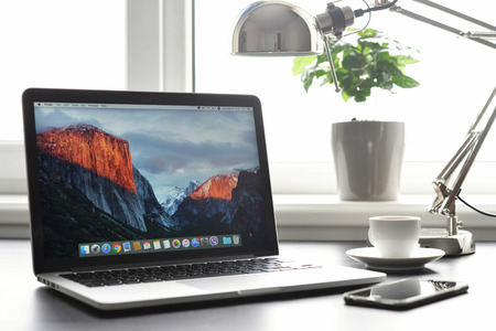 retina display: Kiev, Ukraine - May 15, 2016:Brand new Macbook Pro with with Retina display and OS X EL Capitan on table. MacBook is a brand of notebook computers manufactured by Apple Inc.