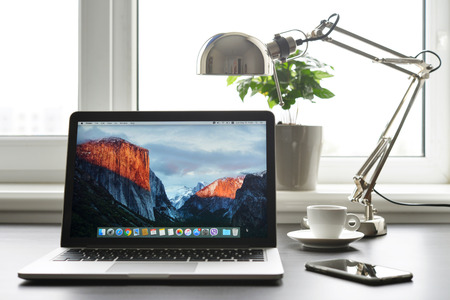 el capitan: Kiev, Ukraine - May 15, 2016:Brand new Macbook Pro with with Retina display and OS X EL Capitan on table. MacBook is a brand of notebook computers manufactured by Apple Inc.