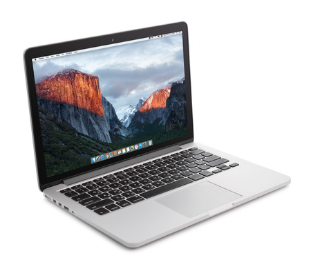 el capitan: Kiev, Ukraine - May 15, 2016:Brand new Macbook Pro with with Retina display and OS X EL Capitan isolated. MacBook is a brand of notebook computers manufactured by Apple Inc.
