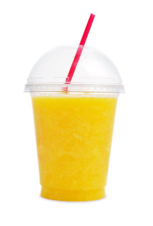 Orange smoothie in plastic transparent cup isolated on white background Фото со стока