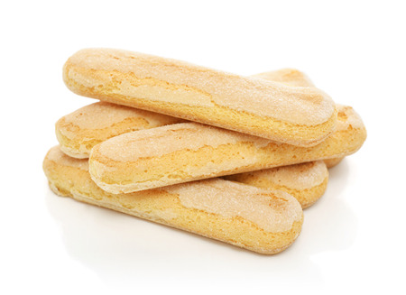 crumbly: Pile of  ladyfinger savoiardi biscuit cookies isolated on white background Stock Photo