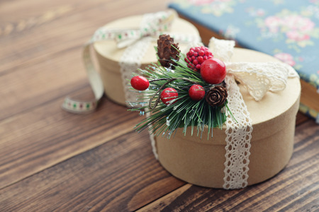 Round gift boxes with vintage lace tape on wooden background Stock Photo