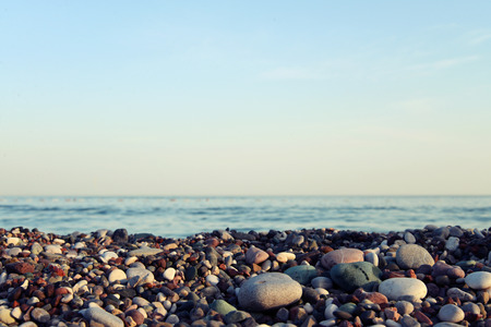gravel: Gravel with sea background on sunset