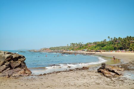 Beautiful Goa province beach in India with people and cows Stock Photo