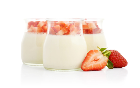 Italian dessert Panna cotta with strawberries in jars isoleted on white Stock Photo