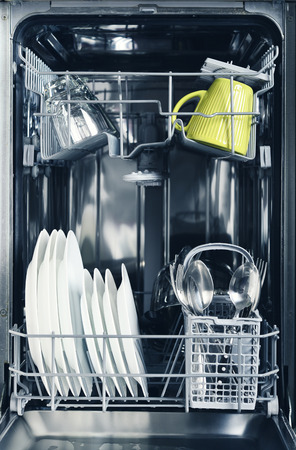 Clean glasses, cups,cutlery and plates after washing in dishwasher machine