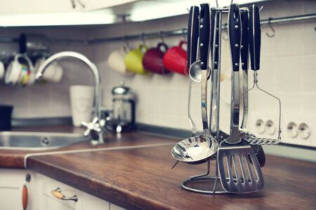 Kitchen utensils on  work top in modern kitchen