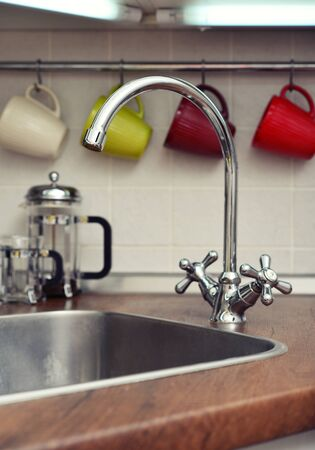 domestic kitchen: Interior of a modern domestic kitchen with water faucet closeup Stock Photo