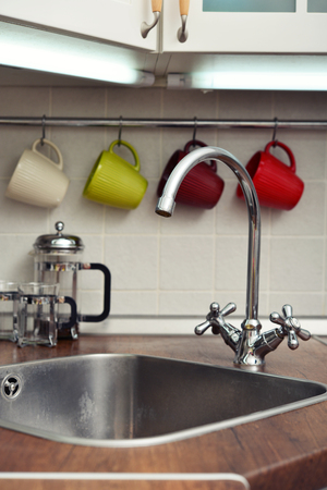 domestic kitchen: Interior of a modern domestic kitchen with water faucet Stock Photo