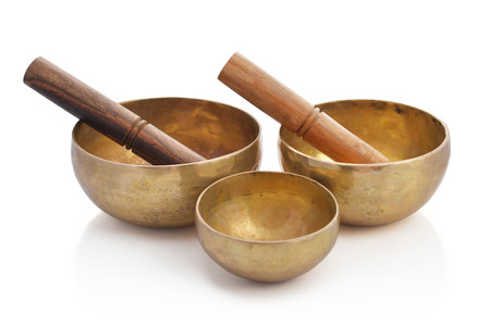 Tibetan handcrafted singing bowls with sticks isolated on white background