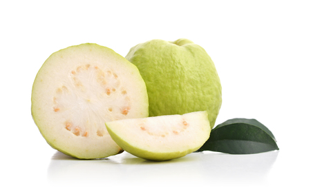 Fresh ripe Guavas with leaves isolated on white background