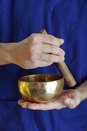 sound healing: Sound Healer with Tibetan Singing Bowl closeup Stock Photo