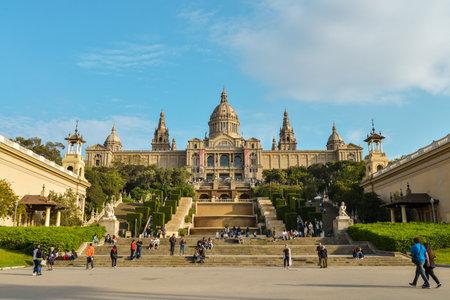 montjuic: Barcelona, Spain - April 15, 2017: Peoples walking and relaxing near National Museum in Barcelona, Placa De Espanya,Spain.