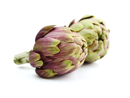 Two fresh artichokes with stem isolated on white background Stock Photo