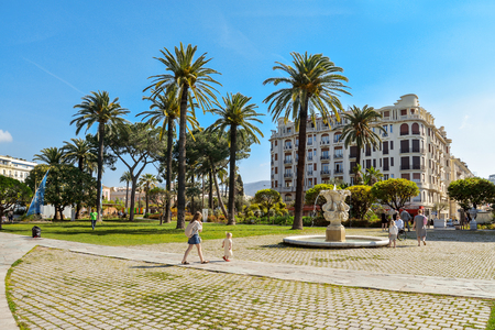 NICE, FRANCE - April 13, 2017: People walking and relaxing in Albert I Gardens next to the famous Massena Place. Editorial