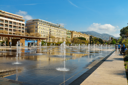 NICE, FRANCE - April 13, 2017: People walking and relaxing at Promenade du Paillon - 12 hectares, 1.2km long new green pedestrian walkway area in the heart of Nice opened on October 26, 2013. Editorial