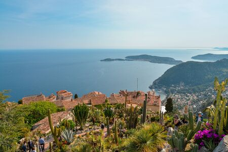 EZE, FRANCE -  April 12, 2017: view from the exotique garden in Eze on the coast of the Cote dAzur, with unidentified people. Eze is famous worldwide for the view of the sea from hill top
