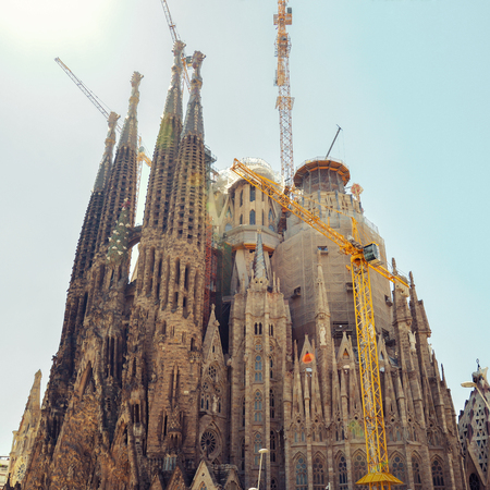 BARCELONA, SPAIN - APRIL 9, 2017: Cathedral Sagrada Familia  in Barcelona, Spain. This impressive cathedral was originally designed by Antoni Gaudi is still being built since 1882.