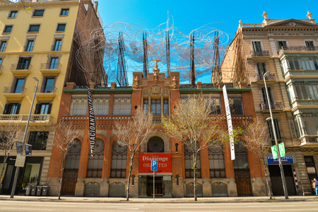 BARCELONA, SPAIN - APRIL 9, 2017: Sculpture of Antoni Tapies on the top of the Fundacio Antoni Tapies building. The museum is located on Carrer dArago street in Barcelona Editorial