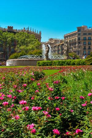 BARCELONA, SPAIN - APRIL 9, 2017:  Beautiful fountain at Plaza Catalunya or Catalonia Square in Barcelona at sunny summer day, Catalonia, Spain Editorial