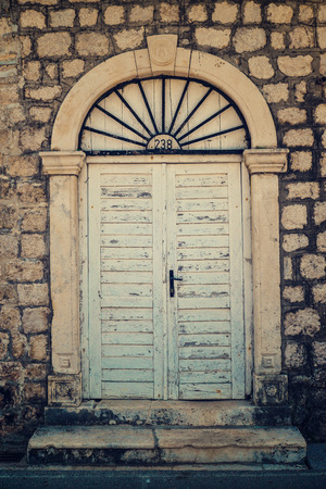Old doors in Dobrota, Montenegro