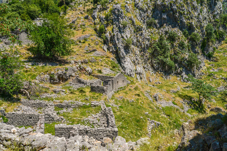 balkans: Ancient ruins and mountain valley landscape near Kotor castle fortress wall in Montenegro. Stock Photo