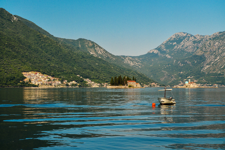 Boat in Boka Kotor bay near Perast and St.George Island Stock Photo