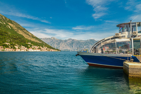 A pleasure boat near the pier on the island next to Perast, Montenegro