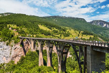 Mountain landscape, Montenegro. Durdevica Tara arc bridge in the mountains, One of the highest automobile bridges in Europe.