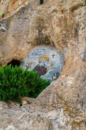 pintura rupestre: OSTROG, MONTENEGRO - JUNE 21, 2017: Mosaics in Ostrog monastery, Montenegro. Ostrog monastery is the most popular pilgrimage place in Montenegro.