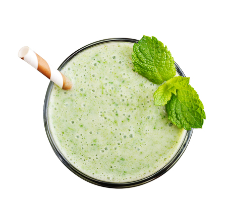 Fresh avocado smoothie with lime, spinach and celery isolated on white background, top view