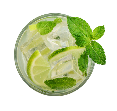 Glass of Mojito cocktail or soda drink with lime and mint isolated on white background, top view Foto de archivo