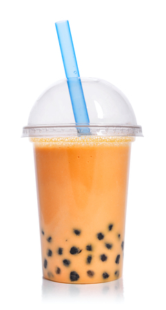 Orange fruit Bubble Tea in a plastic cup with drink straw isolated on white background. Take away drinks concept. Archivio Fotografico