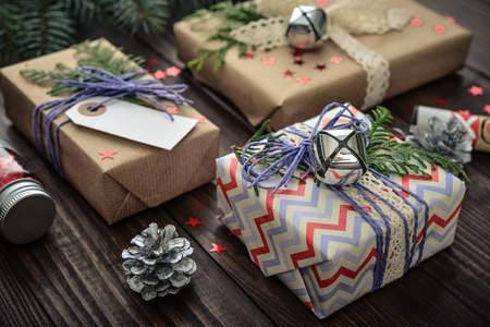 Christmas gifts with christmas decoration on wooden background closeup Reklamní fotografie