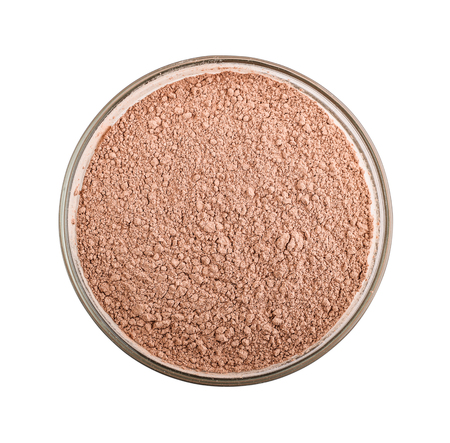 Pink cosmetic clay powder in glass bowl isolated on white background, with clipping path Stock Photo
