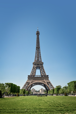 Eiffel Tower and Champ de Mars in Paris, France at sunny day Stock Photo