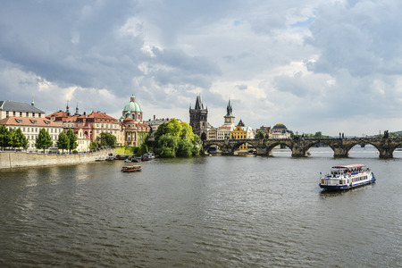 Prague, Czech Republic - May 9, 2018: Scenic spring view of the Old Town pier architecture and Charles Bridge over Vltava river in Prague, Czech Republic