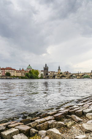 Scenic spring view of the Old Town pier architecture and Charles Bridge over Vltava river in Prague, Czech Republic