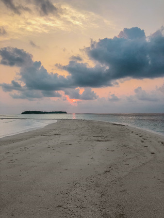 Beautyful sunset in the ocean on sandbank near Fehendhoo island, Maldives