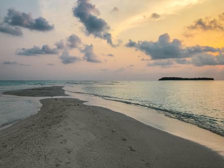 Beautyful sunset in the ocean on sandbank near Fehendhoo island, Maldives